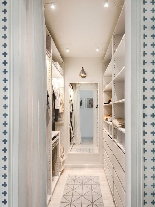 inspiration for a small scandinavian gender neutral walk in closet remodel in saint petersburg - How To Design Walk In Closet