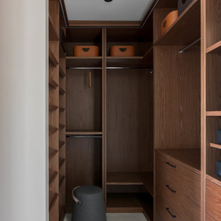Inspiration For A Mid Sized Contemporary Gender Neutral White Floor Walk In  Closet