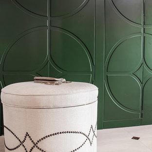 Idée de décoration pour un placard dressing design de taille moyenne pour une femme avec un placard avec porte à panneau surélevé, des portes de placards vertess et un sol en carrelage de céramique.