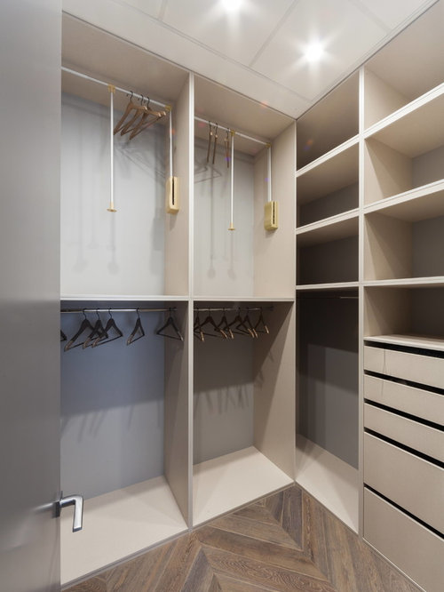 Inspiration for a small contemporary gender-neutral medium tone wood floor  walk-in closet