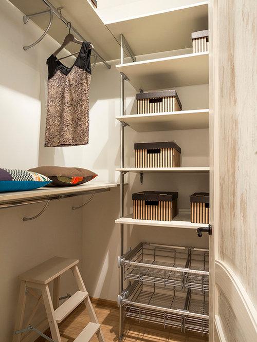 small womenu0027s beige floor walkin closet idea in moscow with open cabinets