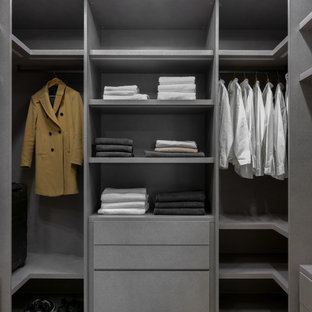 Design ideas for a large scandinavian storage and wardrobe in Moscow with light hardwood floors and beige floor.