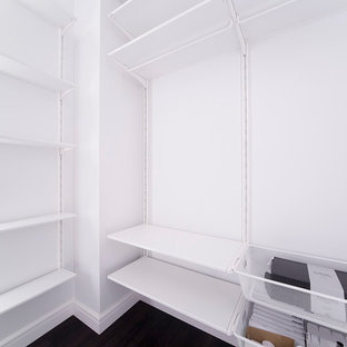 Inspiration for a mid-sized contemporary walk-in wardrobe in Saint Petersburg with black floor.