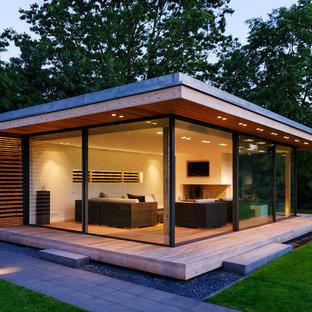 Inspiration för ett stort funkis fristående gästhus