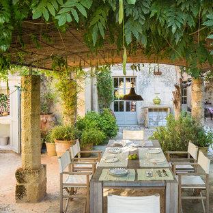 Esempio di un ampio giardino formale mediterraneo esposto in pieno sole dietro casa in estate con pavimentazioni in pietra naturale