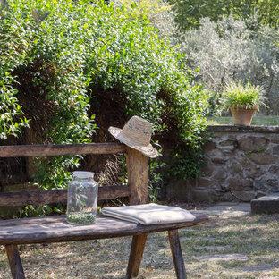 Idee per un giardino xeriscape country di medie dimensioni con pavimentazioni in pietra naturale