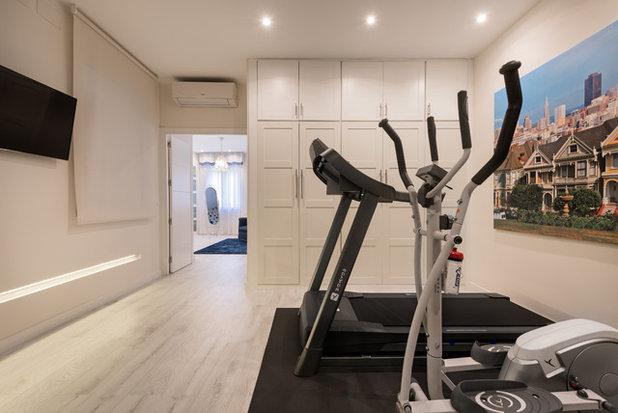 Contemporary Home Gym by AIMA Estudio