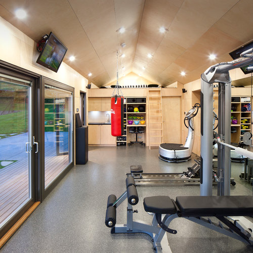 large trendy multiuse home gym photo in barcelona with brown walls and ceramic floors