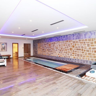 Photo of an expansive mediterranean multi-use home gym in Alicante-Costa Blanca with beige walls, porcelain flooring and brown floors.