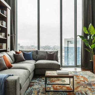 Стильный дизайн: открытая гостиная комната среднего размера в современном стиле с библиотекой, серыми стенами, ковровым покрытием и разноцветным полом без камина, ТВ - последний тренд