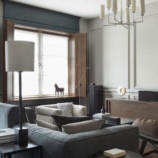 Пример оригинального дизайна интерьера: гостиная комната в современном стиле с серыми стенами