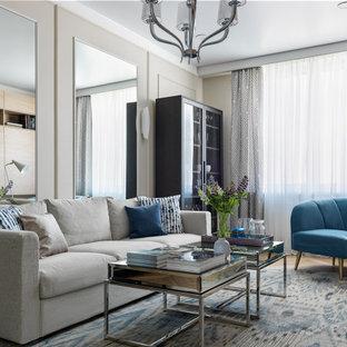 Идея дизайна: гостиная комната в современном стиле с серыми стенами и панелями на части стены