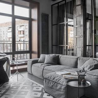 Свежая идея для дизайна: маленькая парадная, открытая гостиная комната в стиле лофт с серыми стенами - отличное фото интерьера