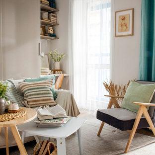 Ispirazione per un piccolo soggiorno minimal aperto con pavimento in laminato, nessuna TV e pavimento marrone