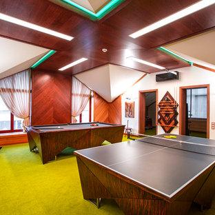 Immagine di un soggiorno contemporaneo con sala giochi, pareti bianche, moquette e pavimento verde