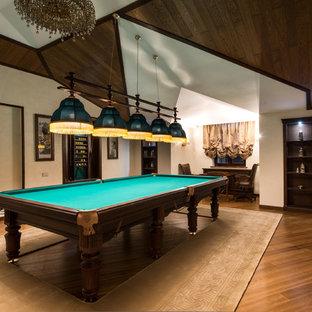 На фото: класса люкс огромные открытые комнаты для игр в классическом стиле с бежевыми стенами, паркетным полом среднего тона и телевизором на стене