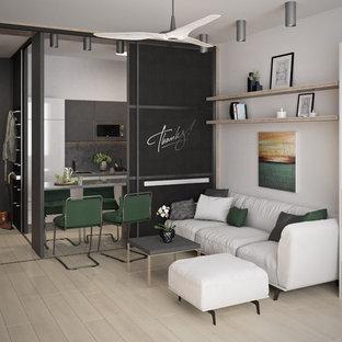 Ejemplo de sala de estar abierta, escandinava, pequeña, con paredes blancas, suelo de linóleo y televisor independiente