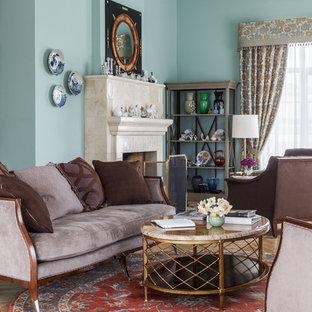 На фото: парадная, открытая гостиная комната в стиле современная классика с синими стенами, светлым паркетным полом, стандартным камином и фасадом камина из плитки с
