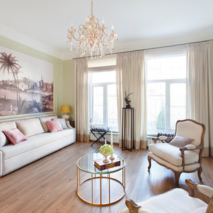 Example of a classic formal and enclosed medium tone wood floor and orange floor living room design in Novosibirsk with green walls, a standard fireplace, a metal fireplace and a wall-mounted tv