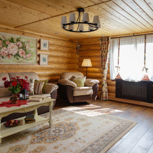 Example of a farmhouse laminate floor, brown floor, shiplap ceiling and wood wall living room design in Other