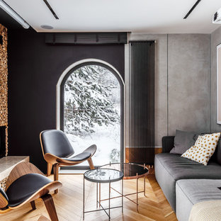 Идея дизайна: маленькая парадная, изолированная гостиная комната в скандинавском стиле с серыми стенами, паркетным полом среднего тона, стандартным камином, фасадом камина из дерева и коричневым полом