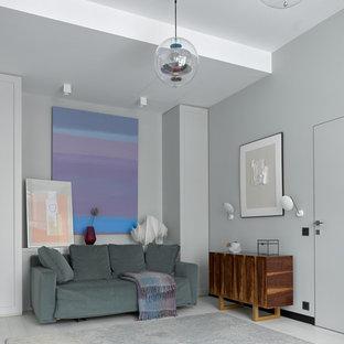Неиссякаемый источник вдохновения для домашнего уюта: гостиная комната в современном стиле с серыми стенами, светлым паркетным полом и белым полом