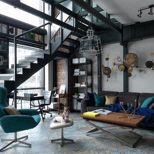 Свежая идея для дизайна: открытая гостиная комната в стиле лофт с серыми стенами и правильным освещением - отличное фото интерьера