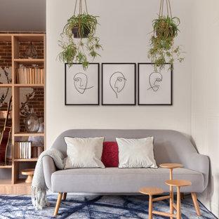 Идея дизайна: гостиная комната в скандинавском стиле с белыми стенами, ковровым покрытием и синим полом