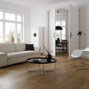 Esempio di un soggiorno minimal con pareti bianche, pavimento in vinile e nessun camino