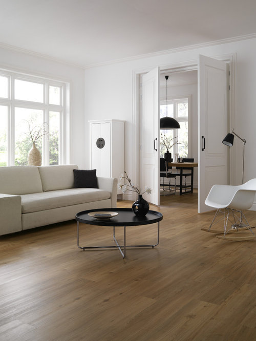 Trendy vinyl floor living room photo in Moscow with white walls Top 100 Vinyl Floor Living Room Ideas  Remodeling Photos Houzz