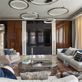 Выдающиеся фото от архитекторов и дизайнеров интерьера: парадная, изолированная гостиная комната в современном стиле с серыми стенами, светлым паркетным полом и телевизором на стене
