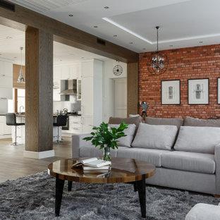 Идея дизайна: большая открытая гостиная комната в стиле современная классика с полом из керамогранита, угловым камином, фасадом камина из плитки, коричневым полом и кирпичными стенами