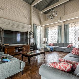 Свежая идея для дизайна: большая парадная, открытая гостиная комната в стиле современная классика с паркетным полом среднего тона, телевизором на стене, коричневым полом и белыми стенами - отличное фото интерьера