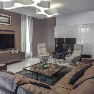 Classic formal living room in Moscow with brown walls, a standard fireplace, a wall mounted tv and white floors.