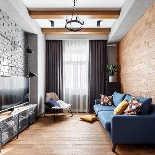 На фото: изолированная, парадная гостиная комната среднего размера в стиле неоклассика (современная классика) с серыми стенами, паркетным полом среднего тона, отдельно стоящим ТВ, бежевым полом, кирпичными стенами, деревянными стенами и балками на потолке