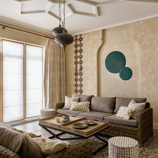 Design ideas for a mediterranean family and games room in Moscow with beige walls.