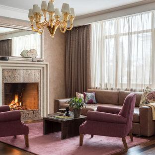 Идея дизайна: большая изолированная, парадная гостиная комната в стиле современная классика с бежевыми стенами, темным паркетным полом, фасадом камина из камня, коричневым полом и стандартным камином