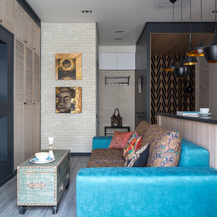 Inspiration for a small eclectic open concept laminate floor living room remodel in Moscow with a wall-mounted tv and beige walls
