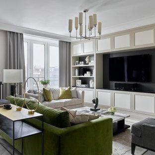Стильный дизайн: гостиная комната в стиле современная классика с белыми стенами, мультимедийным центром и серым полом - последний тренд