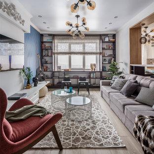На фото: открытая, парадная гостиная комната в современном стиле с светлым паркетным полом, телевизором на стене, бежевым полом и синими стенами без камина с