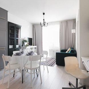 Ispirazione per un soggiorno nordico di medie dimensioni con pareti bianche, pavimento in laminato e pavimento grigio
