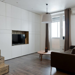 Example Of A Small Trendy Laminate Floor Living Room Design In Moscow With White Walls And
