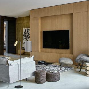 На фото: класса люкс большие парадные, открытые гостиные комнаты в современном стиле с бетонным полом, телевизором на стене, бежевыми стенами и серым полом