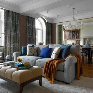 На фото: парадная, открытая гостиная комната среднего размера в стиле современная классика с коричневыми стенами, паркетным полом среднего тона и коричневым полом без камина