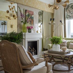 Неиссякаемый источник вдохновения для домашнего уюта: парадная гостиная комната в стиле современная классика с желтыми стенами и стандартным камином