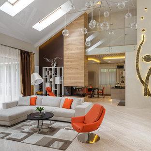 Immagine di un ampio soggiorno contemporaneo aperto con pareti beige, parquet chiaro, camino bifacciale e cornice del camino in legno