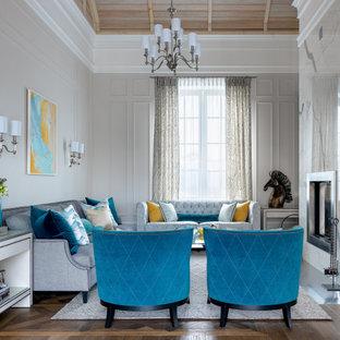 Свежая идея для дизайна: гостиная комната в стиле современная классика с серыми стенами, двусторонним камином, фасадом камина из плитки, коричневым полом и потолком из вагонки - отличное фото интерьера
