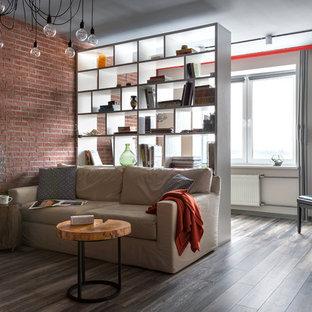 Immagine di un soggiorno minimal di medie dimensioni e aperto con sala della musica, pareti grigie, pavimento in laminato e pavimento grigio