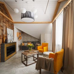 Diseño de salón cerrado, contemporáneo, con paredes blancas, suelo de corcho, marco de chimenea de metal, suelo gris y chimenea tradicional