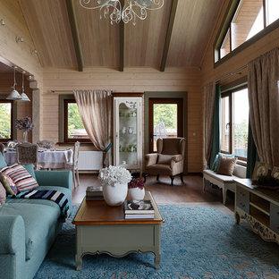 На фото: парадные, открытые гостиные комнаты в стиле кантри с коричневыми стенами, темным паркетным полом и коричневым полом без ТВ